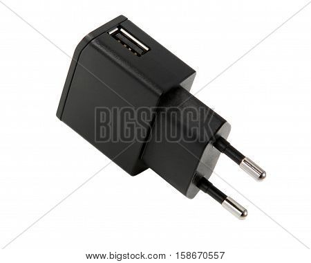 Usb charger. Electrical adapter to USB ports on white background