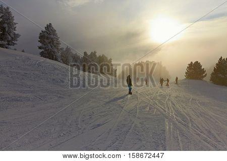 Skiing on misty winter slopes