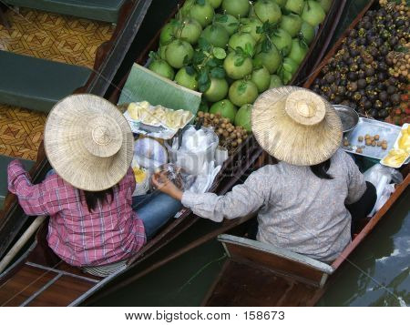 Two Women In A Floating Market