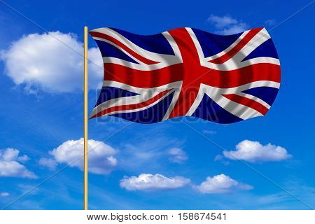 British national official flag. Patriotic UK symbol. Union Jack. Great Britain banner. Correct colors. Flag of the United Kingdom on flagpole waving in the wind blue sky background. Fabric texture. 3D rendered illustration