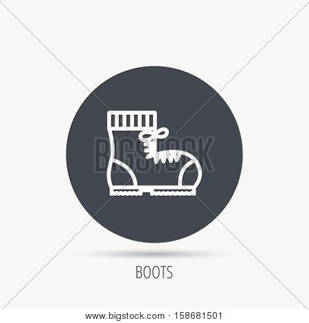 Boot icon. Hiking or work shoe sign. Military footwear symbol. Round web button with flat icon. Vector