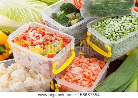 Fresh frozen vegetables food in plastic containers. Healthy freezer food and meals.