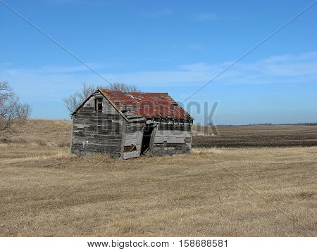 An abandoned farm building left from a old farmstead.