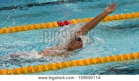 Hong Kong China - Oct 29 2016. American competitive swimmer LIANG Alex Wang (USA) swimming backstroke. FINA Swimming World Cup Preliminary Heats Victoria Park Swimming Pool.