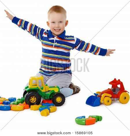 Little Boy Playing With Color Toys On Floor