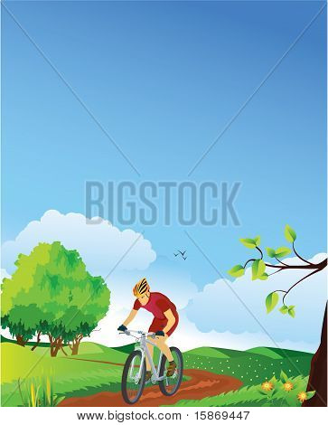 Spring landscape with a mountain biker.