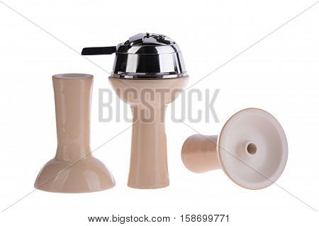 hookah bowl for tobacco shisha three ceramic products with one metal cap, pottery arranged in a row, three beige glazed vessels with metal top, pottery with metal top stands right and second is reversed and third lays