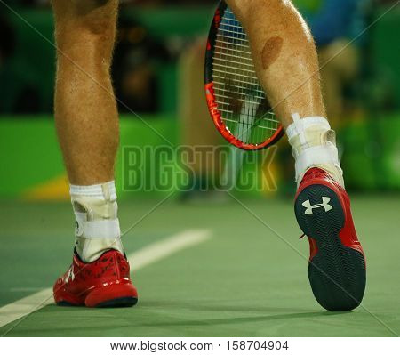 RIO DE JANEIRO, BRAZIL - AUGUST 14, 2016: Olympic champion Andy Murray of Great Britain wears custom Under Armour tennis shoes during men's singles final of the Rio 2016 Olympic Games