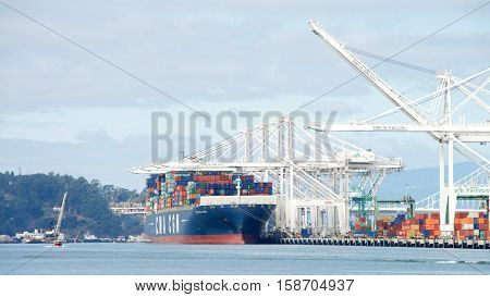 Oakland CA - October 11 2016: Cargo ship CMA CGM LIBRA loading at the Port of Oakland the fifth busiest port in the United States.