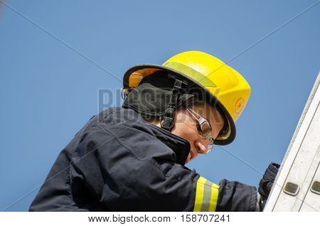 Girl At Entrance Exams To Firefighter School