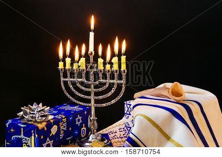 Jewish Holiday Hanukkah With Menorah Over Wooden Table