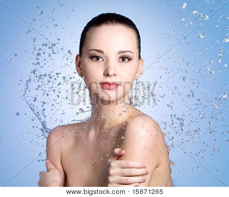 Splashes Of Water On The Woman