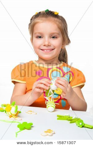 Happy little girl with easter eggs.