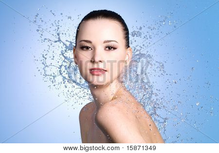 Beauty Portrait Of Woman With Splashes Of Water
