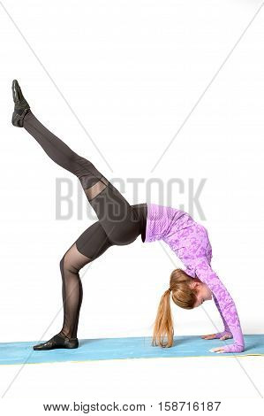Beautiful cool young fit woman in sportswear doing sport exercise backbend One-legged Upward Bow (Wheel) Posture Eka Pada Urdhva Dhanurasana full length side view studio shot white background