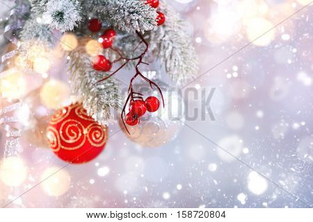 Christmas Holiday Background, Hanging baubles on Christmas tree, New Year backdrop, Decoration. Abstract Silver Blurred Bokeh, Blinking Garland. Christmas Tree decorated, Lights Twinkling