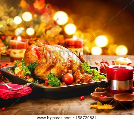 Christmas Turkey Dinner. Roasted Turkey. Winter Holiday table served, decorated with candles. Roasted chicken, table setting.