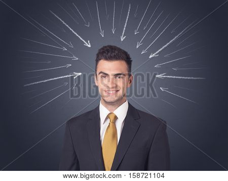 Young businessman with arrows pointing to his head
