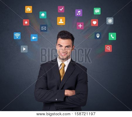 Young businessman with colorful applications over his head