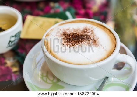 Cappuccino or latte coffee at the coffee shop.