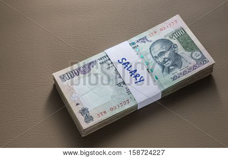 Employees salaries in cash. Rs hundred notes sealed with paper band.