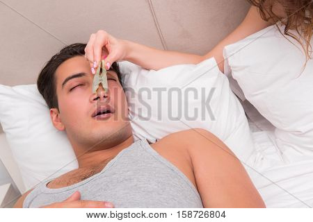 Woman having trouble with husband snoring
