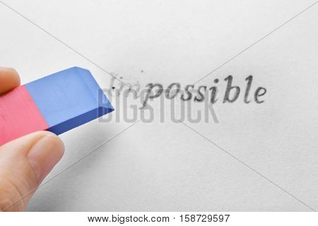 Hand erasing word impossible on paper