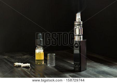 Vape Or E-cigarette. Vaping Set On The Table.