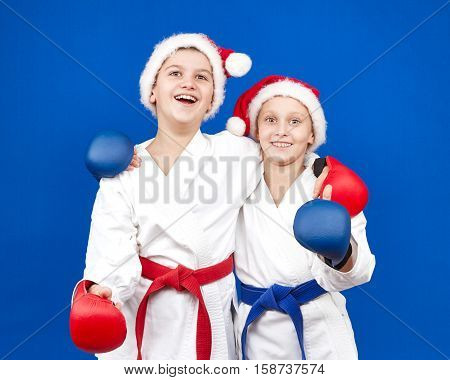 Children in Santa Claus caps and of red and blue overlays on hands