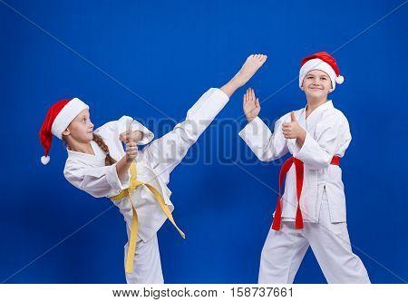 Girl beats kicking the boy shows a finger super