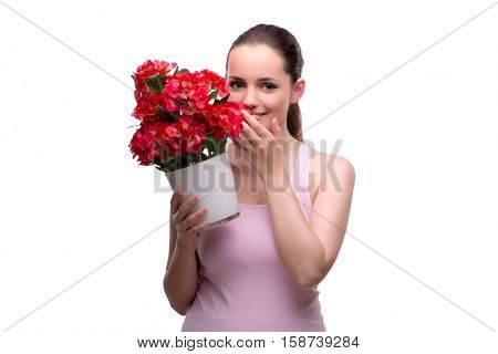 Woman with pot of red flowers isolated on white