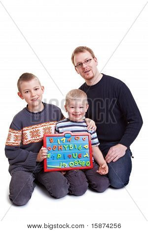 Father Teaching His Boys With Magnetic Board