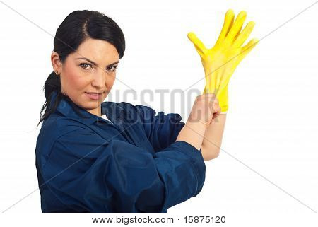 Cleaning Worker Woman Puts Protective Glove