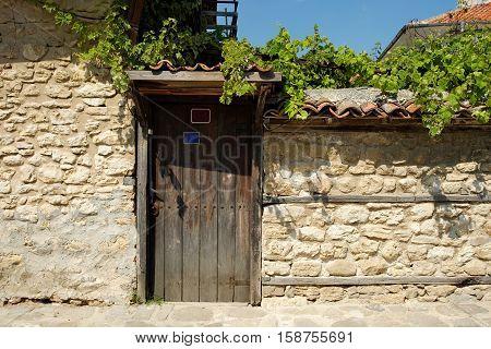 Door on street in old town of Nesebar Bulgaria