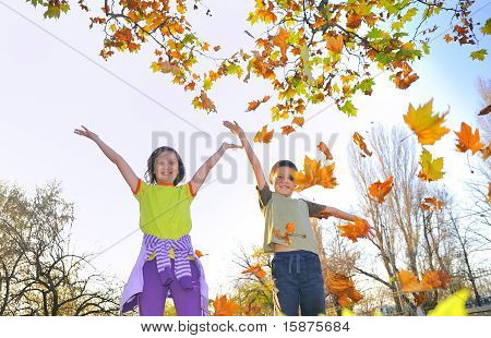 kids playing with leaves