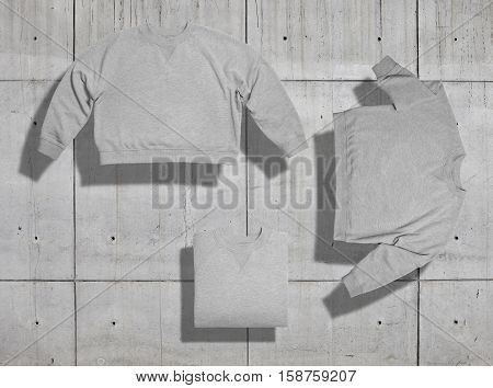 Set of three shots of light heather gray blank short womens sweatshirt arranged in different ways on industrial background for merchandise presentation