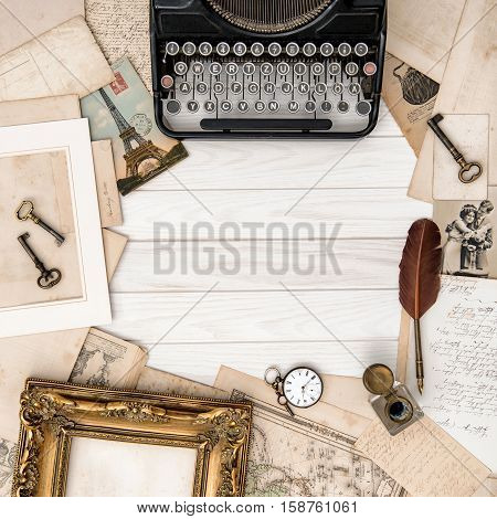 Antique typewriter and vintage office tools on wooden table. Flat lay