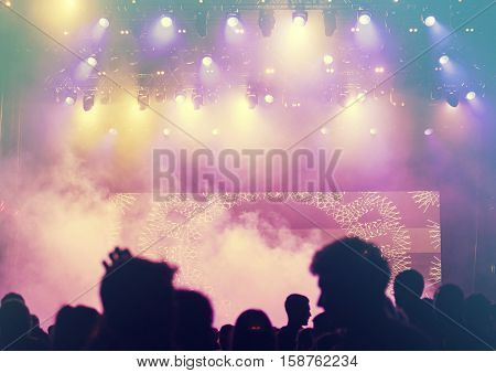Crowd at concert and colorful stage lights