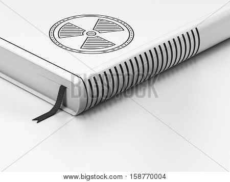 Science concept: closed book with Black Radiation icon on floor, white background, 3D rendering