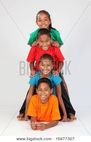 Fun kids form a totem pole