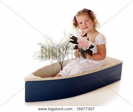 Pretty Preschooler In A Blue Boat