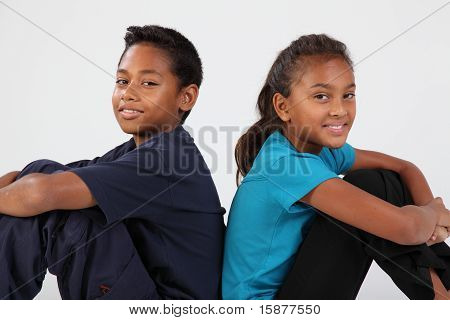 Boy and girl back to back