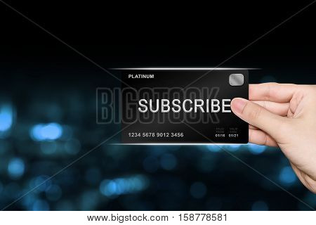 hand picking subscribe platinum card on blur background