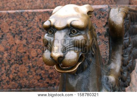 photo Sculpture of a lion's head of brass in Russia