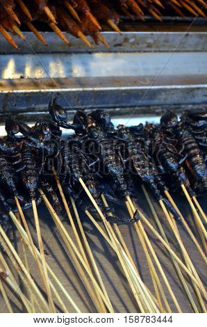 Chinese street food in the Hutongs of Beijing Wangfujing Street roasted scorpions as snack street food in China