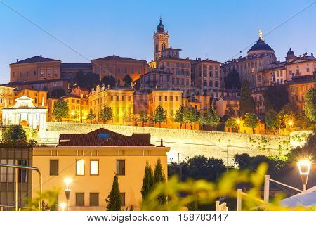 Medieval Upper town Citta alta of Bergamo with towers and churches at sunset, Lombardy, Italy