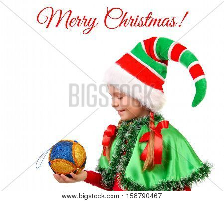 Girl in suit Santa's elf with a Christmas ball. Isolated on a white