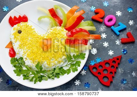 Funny or rooster salad symbol of New Year 2017