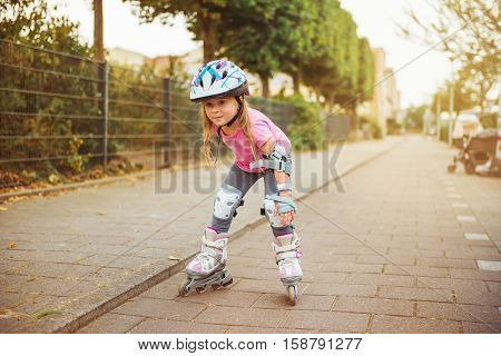 Young happy skater trying exciting outdoor activity