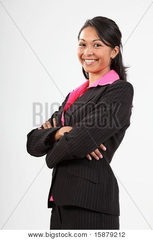 Young business woman arms folded